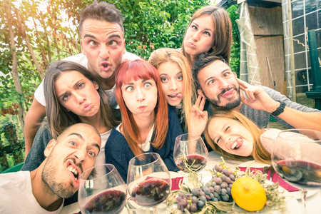 best group: Best friends taking selfie outdoor with back lighting - Happy youth concept with young people having fun together drinking wine - Cheer and friendship at grape harvest time - Soft desaturated filter
