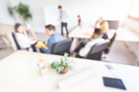 Blurred defocused background of businesspeople meeting with concentrated start up entrepreneur coworkers - Business concept with young people team in modern minimal office - Bright  desaturated filter Stock Photo