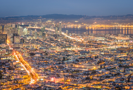 bay area: Skyline of San Francisco Bay at night from panorama view point lookout of Twin Peaks - Urban travel concept with american world famous city on the atlantic coast - warm night color tones Stock Photo