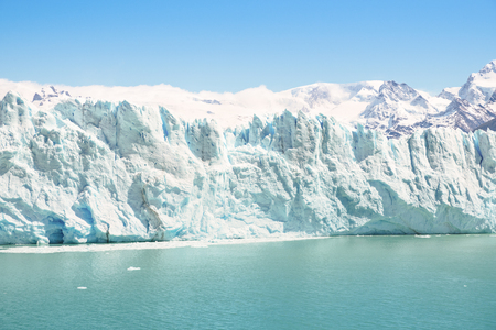 calving: Frontal detailed view of Perito Moreno glaciar in argentinian Patagonia - World famous nature wonder of south american country of Argentina - Natural azure turquoise light blue color tones