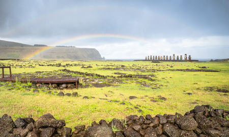 rapa nui: Double rainbow on panoramic view of Ahu Tongariki moai archeological site area on world famous Rapa Nui ( Easter Island ) in Chile - Travel wanderlust concept - Vivid filter on dramatic cloudy sky