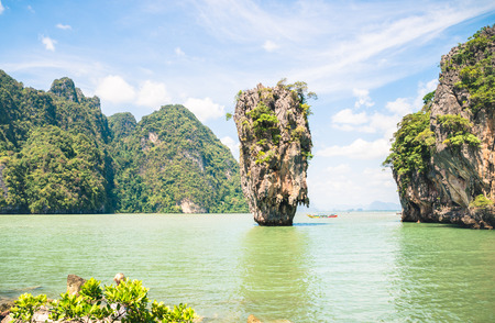 paradise bay: James Bond Island in Phang Nga Bay - World famous destination near Phuket in Thailand - Wanderlust travel concept with paradise landscape on turquoise water and thick vegetation - Bright vivid filter Stock Photo