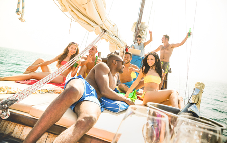 luxuries: Group of multiracial friends having fun at sail boat party with dj set - Friendship concept with young multi racial people on sailboat - Travel lifestyle on exclusive vibe mood - Warm bright filter