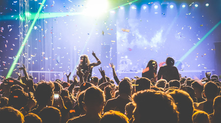 after party: Young people dancing at night club - Hands up and multicolored confetti at nightclub after party - Nightlife concept with afterparty crowd celebrating dj concert festival event - Retro contrast filter Stock Photo