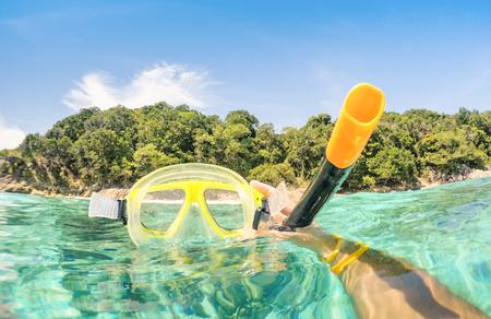 Adventurous guy taking photo of snorkeling mask underwater - Adventure travel lifestyle enjoying happy fun moment at Similan Islands beach - Trip around world nature wonders - Warm turquoise filter
