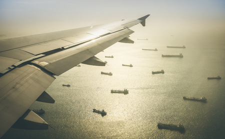 harbour: Aerial view of industrial cargo ships fleet moving to the harbour of Singapore in south east Asia - Retro contrasted dramatic filter