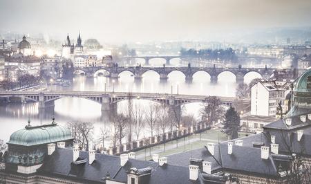Prague and Vltava river from Letna Hill - Romantic view after misty sunset with emotional foggy atmosphere - European capital of bohemian Czech Republic - Blue cobalt desaturated color filter Reklamní fotografie - 75264773