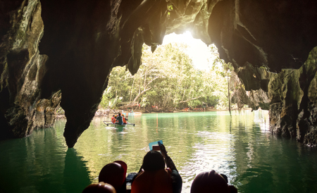 Inside view point of Puerto Princesa Palawan subterranean underground river at exit side - Adventurous exclusive Philippines destinations - Dark lighting with real feelings from visitor perspective 写真素材