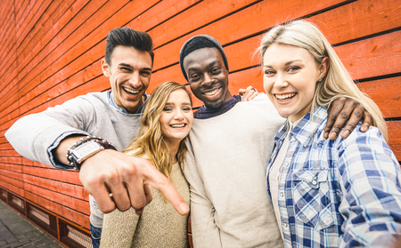 Happy multiracial friends group taking selfie with mobile smart phone - Young hipster people addicted by smartphone on social network community - Lifestyle technology concept on vivid contrast filter Stock fotó - 89173794