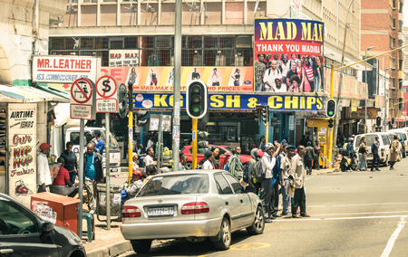 JOHANNESBURG, SOUTH AFRICA - NOVEMBER 13, 2014: rush hour and traffic jam near Von Wiellig Street at crossroad with Commissioner St in the crowded and modern multiracial metropolis of South Africa Editorial