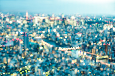 Aerial bokeh of Tokyo skyline from above after sunset on blue hour - Japanese world famous capital with spectacular nightscape panorama - Vintage azure filter on blurred defocused night lights 版權商用圖片