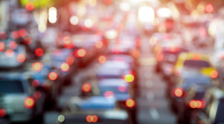 Rush hour with defocused cars and generic vehicles - Traffic jam in Los Angeles downtown - Blurred bokeh postcard of american iconic city with dark contrast sunshine filter - Transportation concept Banco de Imagens