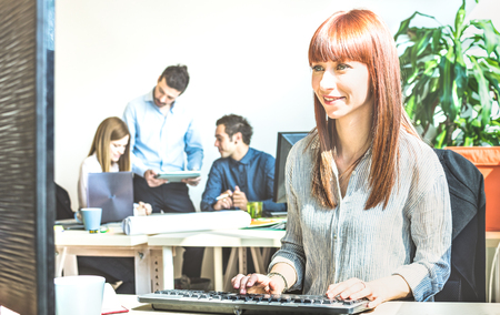 Young business woman having fun working at computer with coworkers at office meeting - Modern start up concept of engagement connected with happy productive attitude - Bright vivid contrast filter