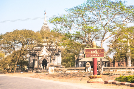 Old Bagan town in Myanmar Burma - Wooden entrance sign to the ancient City - Wanderlust travel concept to world famous exclusive destinations - Warm afternoon color tone filter