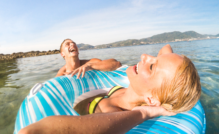 Young couple vacationer having genuine fun on tropical Phuket beach in Thailand - Snorkel tour in exotic scenario - Active youth love and travel concept around world - Bright warm color filter tones Standard-Bild