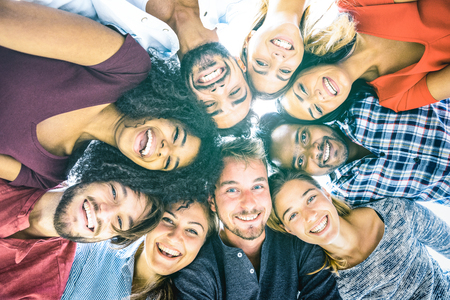 Multiracial best friends millennials taking selfie outdoors with back lighting - Happy youth friendship concept against racism with international young people having fun together - Azure filter tone