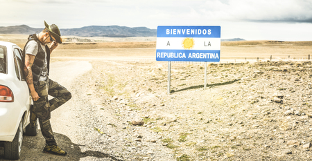 Young man solo traveler at relax break near argentinian border in south america Patagonia - Adventure wanderlust concept on world famous nature wonder in Argentina on the way to Chile - Vintage filter