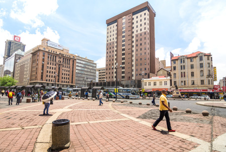 JOHANNESBURG, SOUTH AFRICA - NOVEMBER 13, 2014: everyday life at Gandhi square - After work in progress finished in 2002 the area got renovated bus terminal with 24 hour security and many new shops Editorial