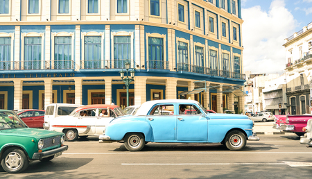 HAVANA, CUBA - NOVEMBER 17, 2015: vintage classic cars driving near Galician Palace on Prado Street at the beginning of