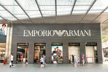 SINGAPORE - DECEMBER 2, 2015: Emporio store on Orchard Road - The core business is an Italian luxury fashion house founded by Giorgio Armani - The company also operates a range of cafes worldwide Imagens - 115968230