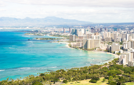 Panorama skyline view of Honolulu city and Waikiki beach in the pacific island of Oahu in Hawaii - Postcard from Diamond Head crater of exclusive travel destination - Warm day filter