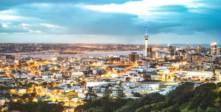 Auckland skyline from Mount Eden after sunset during blue hour - New Zealand modern city with spectacular nightscape panorama -  Enhanced filter on night lights