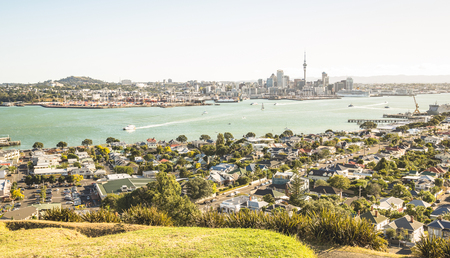 Breathtaking view of Auckland city skyline and bay gulf from Mount Victoria in Devonport area - High angle sight of the New Zealand world famous town - Bright greenish vintage filter
