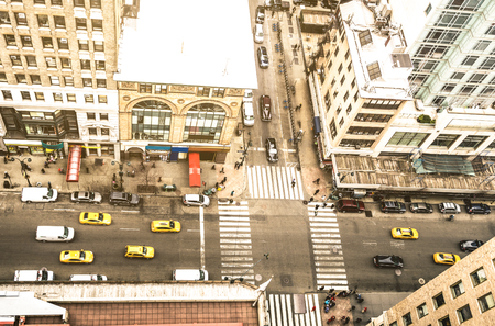 Aerial view of New York street and classic building in Manhattan financial district - High angle from skyscraper in urban business downtown area - United states world famous city - Warm vintage filter