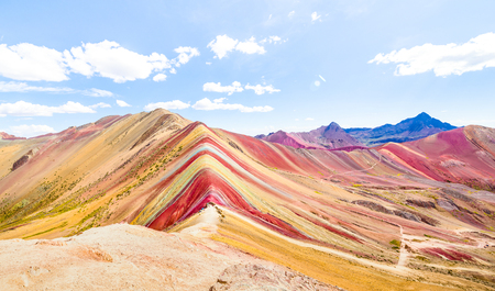 Panoramic view of Rainbow Mountain at Vinicunca mount in Peru - Travel and wanderlust concept exploring world nature wonders - Vivid multicolor filter with bright enhanced color tones Stock Photo