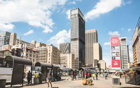 JOHANNESBURG, SOUTH AFRICA - NOVEMBER 13, 2014: everyday life at Gandhi square - After work in progress finished in 2002 the area got full operative bus terminal with 24 hour security and new shops
