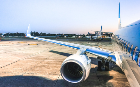 Airplane at terminal gate ready for takeoff at blue hour - Modern international airport with boarding aircraft on nighttime - Alternative lifestyle and wanderlust travel concept wandering around world Stock Photo