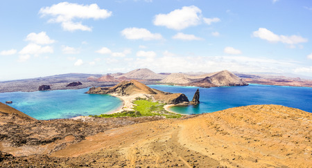 Panoramic view of Isla Bartolome at Galapagos Islands archipelago - Travel and wanderlust concept exploring world nature wonders around Ecuador - Vivid filter with warm bright color tones