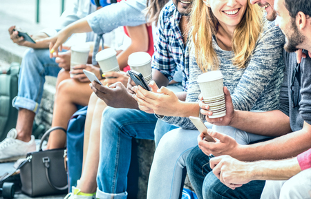 Millenial friends group using smartphone with coffee at university college - People hands addicted by mobile smart phone - Technology concept with always connected trendy millennials - Filter image
