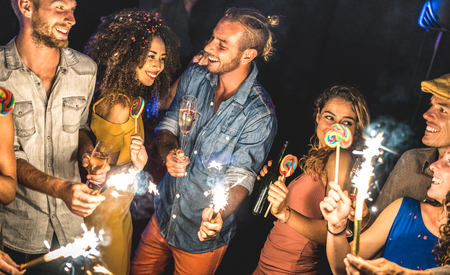 Multiracial friends having drunk fun at summer festival celebration - Young people drinking and dancing at after party in night club - Friendship concept on excited mood - Focus on blue jeans man face Stok Fotoğraf
