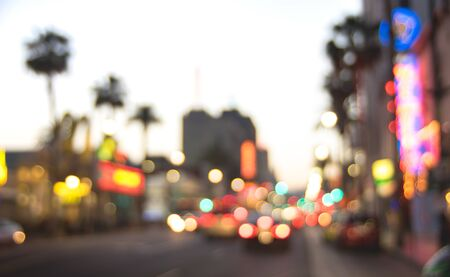 Blurred background of Hollywood Boulevard after sunset -  Defocused view of world famous Walk of Fame in California - United States of America wonder - Warm contrast filter with tilted composition
