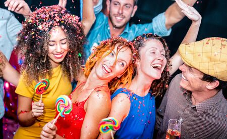 Multiracial friends having drunk fun at after party celebration - Young people dancing at night club - Friendship concept on cool entertainment mood - Vivid filter with focus on red hair girl