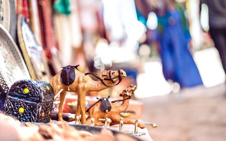 Small wooden dromedary camel at street market in Morocco - Travel shopping concept with manufactured handmade objects - Bright filter on blurred background and tilted composition Фото со стока - 142271049
