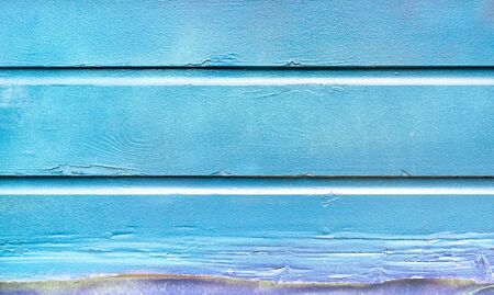 Blue painted background and alternative construction material - Wooden textured panel in outer fence structure - Retro old fashioned backdrop pattern - Vivid azure wood filter