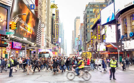 NEW YORK - MARCH 27, 2015: melting pot people crossing road on 7th Avenue intersection with W 42nd Street - Everyday life in the heart of Manhattan southbound below Central Park - Vivid colors