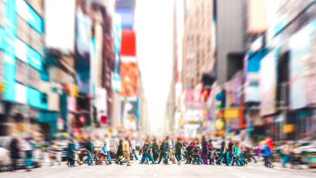 Defocused background of people walking on zebra crossing on 7th avenue in Manhattan - Crowded streets of New York City during rush hour in urban area - Vivid sunset filter with soft sharp focus Banque d'images