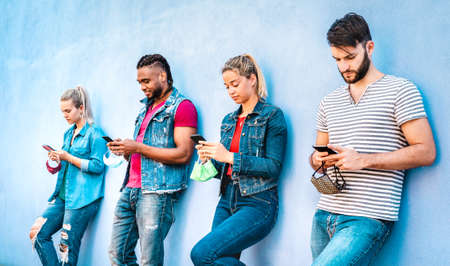 Multiracial people wearing open face mask using tracking app with mobile smart phones - Young milenial friends watching content on social media - New normal life style concept on bright azure filter