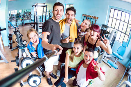 Happy young friends taking selfie after reopening of gym studio center - Sporty people ready for fitness training time together - Healthy life style and sport concept on bright azure filter 스톡 콘텐츠