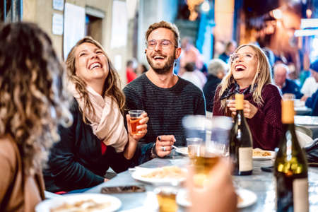 Happy friends having fun drinking white wine at street food festival - Young people eating local plate at restaurant reopening together - Travel and dinning lifestyle concept on azur light neon filter
