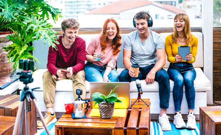 Young people startupper having fun on streaming platform with web cam - Start up marketing concept with millennial guys and girls sharing live vlog feed on social media network