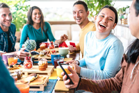 People group talking at coffee bar restaurant - Friends having fun together at rooftop cafeteria on brunch time - Life style concept with happy men and women at cafe venue