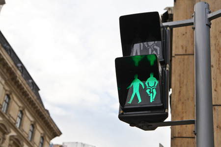 Green signal light for pedestrian and bicycle rider in Vienna, Austria photo