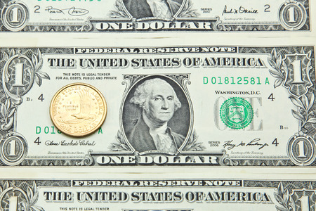 One US dollar banknotes and coin