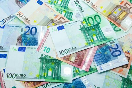 Pile of Euro banknotes in 10, 20, 50, and 100