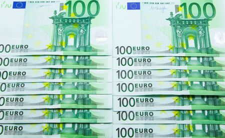Pile of 100 Euro banknotes background