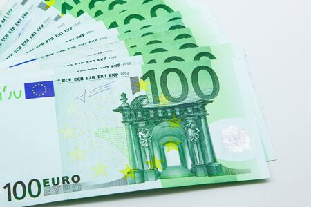 Isolated pile of 100 Euro banknotes